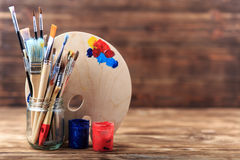 Artist`s workshop.Items for children`s creativity on a wooden background. Acrylic paint and brushes on white wooden background. Pi. Cture with copy space and for Royalty Free Stock Photo