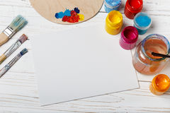 Artist`s workshop.Items for children`s creativity on a wooden background. Acrylic paint and brushes on white wooden background. Pi. Cture with copy space and for Stock Photography