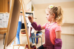 Artist school girl painting watercolor brush Royalty Free Stock Image