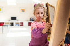 Artist school girl painting watercolor brush Royalty Free Stock Photo