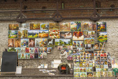 Artist selling his paintings in the old town of Krakow, Poland Royalty Free Stock Photo