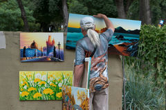 Artist selling paintings Royalty Free Stock Image