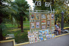 The artist selling pictures in the park Royalty Free Stock Photography
