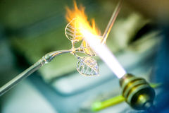 Artist shaping hot glass into a figurine with gas Royalty Free Stock Images