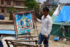 Artist show his painting damaged after earthquake disaster Royalty Free Stock Images