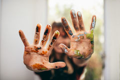 Artist showing her messy hands royalty free stock photo