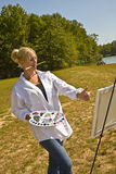 Artist Sizing Up Painting Stock Images