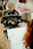 Artist sketching senior woman Stock Photography