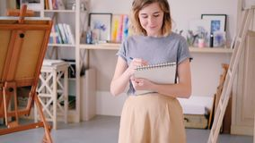Artist sketching woman standing drawing creating stock video