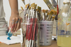 Artist Squeezing Paint On Palette royalty free stock photography