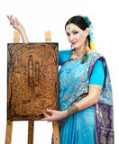 Artist standing at the easel with pyrography painting Eternal Ha Royalty Free Stock Photos