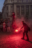 Artist on stilts. Artist performing on stilts on the street with a red flame at night time during the B-FIT event on June 6, 2015 in Bucharest, Romania. B-FIT in Stock Photo