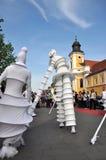 Artist on stilts, street theater Royalty Free Stock Photography