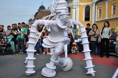 Artist on stilts, street theater Royalty Free Stock Images