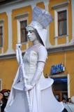 Artist on stilts, street theater Stock Photos