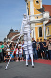 Artist on stilts, street theater Royalty Free Stock Images