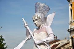 Artist on stilts, street theater Royalty Free Stock Image