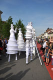 Artist on stilts, street theater Stock Photo