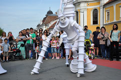 Artist on stilts, street theater Stock Image