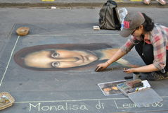 Artist streets of Florence. A street artist draws Mona Lisa, the famous Leonardo da Vinci painting, on asphalt in Florence, Italy Stock Photos