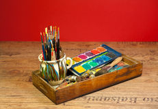 Artist studio painting art supplies brushes and colors Royalty Free Stock Image