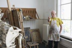 Artist Studying Skeleton In Studio Stock Images
