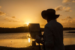 Artist at sunset Royalty Free Stock Photography