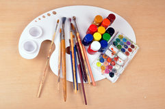 Artist supplies. Set of artist supplies on wooden background royalty free stock photo