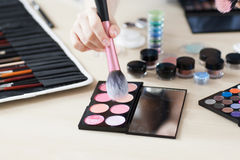 Artist taking rouge with brush visagiste workplace Royalty Free Stock Image