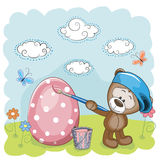 Artist Teddy Bear. Cute Teddy Bear with brush is colored an egg Royalty Free Stock Image