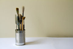 Artist theme: brushes and pallete knife in tin Royalty Free Stock Photo