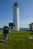 Artist at Tibbetts Point Lighthouse. This is a photo of a retiree pursuing a life-long interest on art. She is working with watercolors stock photos