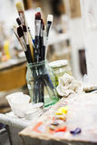 Artist Tools. In a jar of glass in a studio Royalty Free Stock Photo