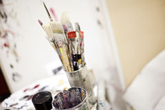 Artist Tools. In a jar of glass in a studio Royalty Free Stock Photos
