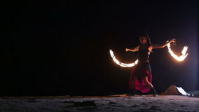 Artist turns the fiery fire-fans  fire performance Stock Image