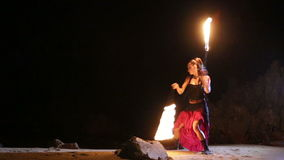 Artist turns the fiery fire-snakes fire performance Stock Photography
