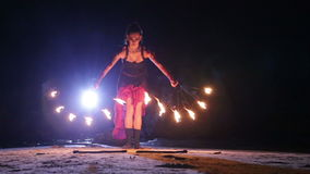 Artist turns the fire fans performance stock footage