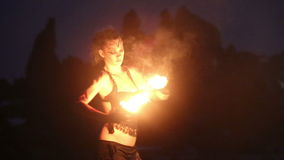 Artist turns the fire palm torches performance stock footage