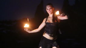 Artist turns the fire palm torches performance stock video footage