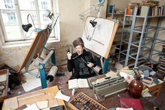Artist in untidy studio Stock Photography