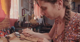 Artist using Acrylic colors to decorate wood stock video