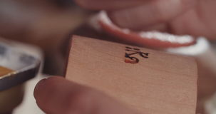 Artist using Acrylic colors to decorate wood stock footage