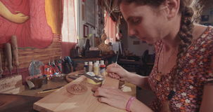 Artist using Acrylic paint colors to decorate wood stock video footage