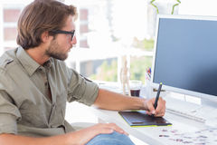 Artist using graphics tablets. Sitting at desk Stock Images