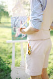 Artist with watercolor painting of bride in wedding dress outdoo Royalty Free Stock Photos