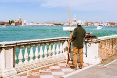 Artist on the waterfront of Venice, Italy Stock Photos