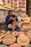 Artist weaving handicraft items Stock Image