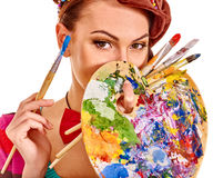Artist woman with paint palette Stock Photos