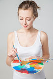 Artist woman with paint palette. Isolated. Stock Photo