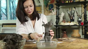 Artist woman sculpts from a clay stock video footage